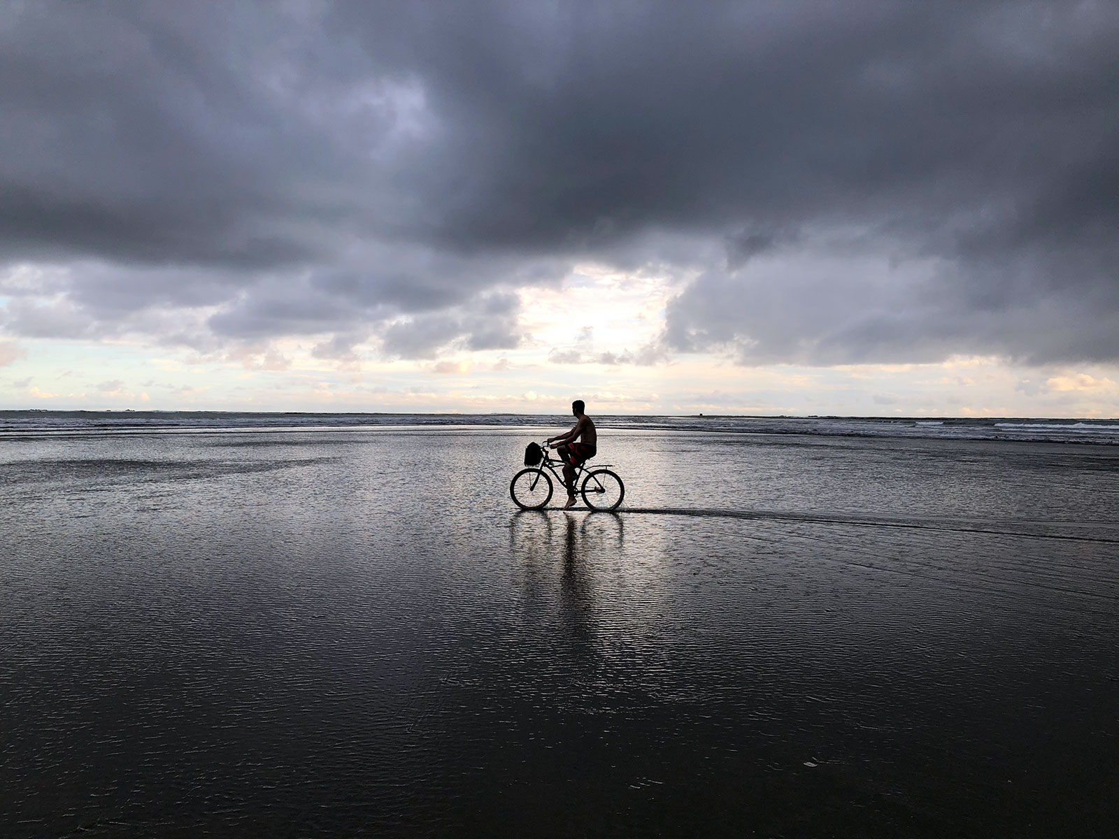 Jimmy riding a bike on the beach